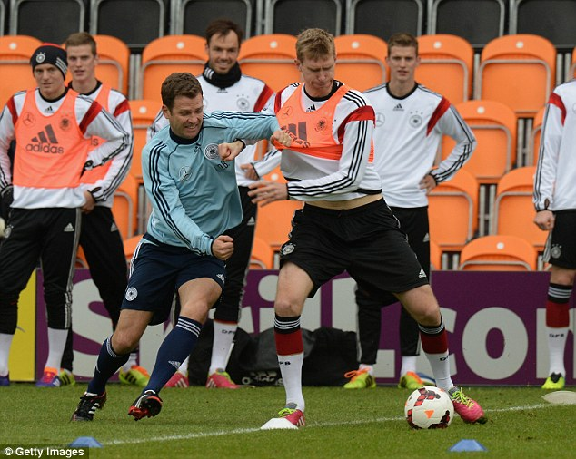 Battle: Oliver Bierhoff (left) attempts to get the better of Per Mertesacker