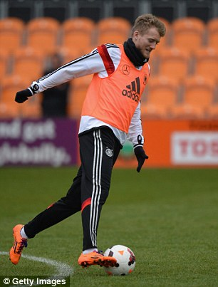On the ball: Andre Schurrle of Germany in action during the training session at The Hive , Barnet