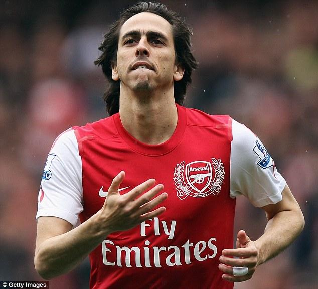 Gunner: Benayoun celebrates scoring Arsenal against Norwich in the Premier League