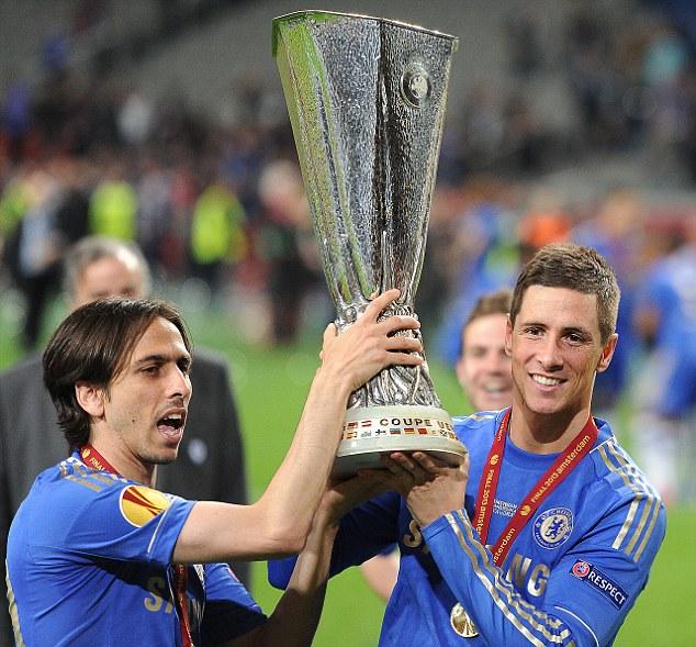 Silverware: Benayoun (left) lifts the Europa League trophy with Fernando Torres in 2013