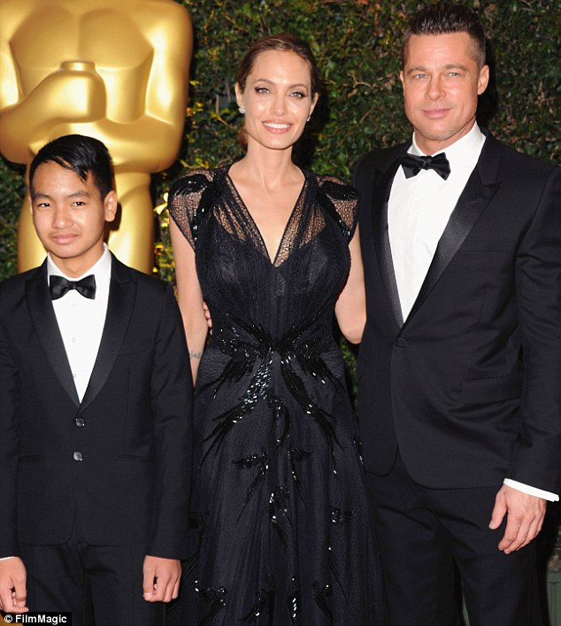 Family ties: Jolie thanked partner Brad Pitt and son Maddox in her speech