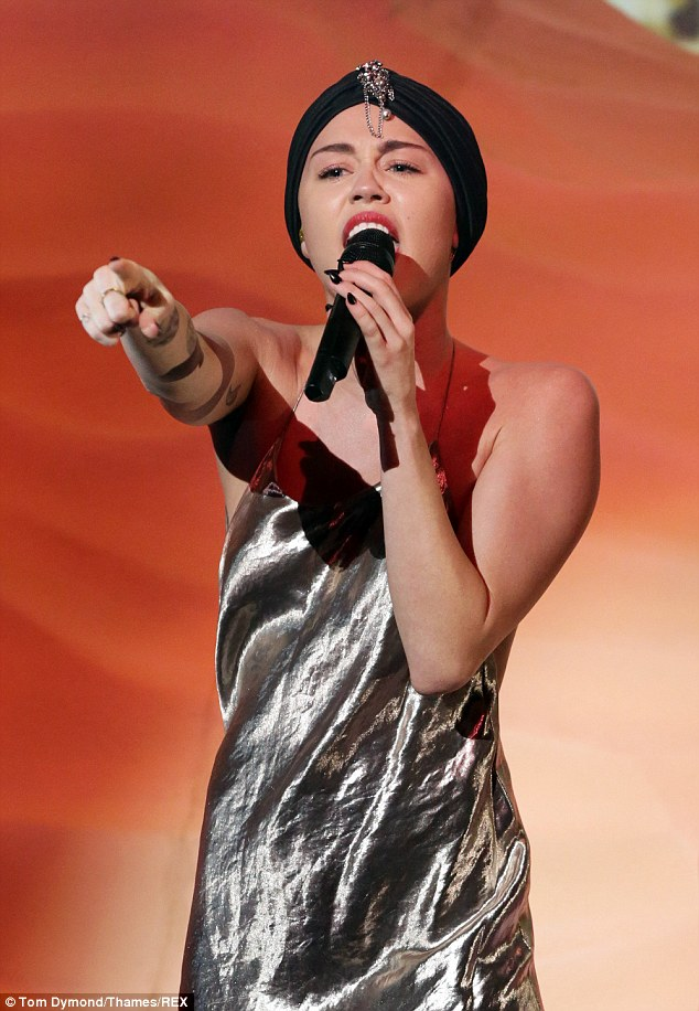 Miley's rendition of Wrecking ball began sitting on top of a fake sand dune but her vocals didn't impress viewers of the X Factor