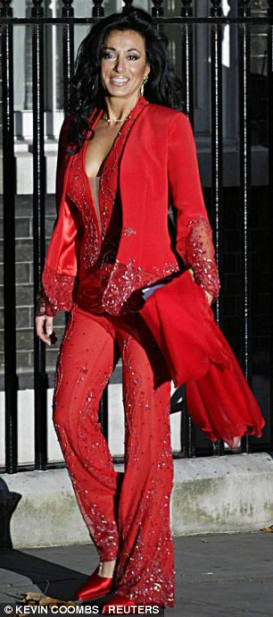Lady in red: Nancy Dell'Olio in THAT catsuit, the sort her unfaithful former boyfriend Sven hated
