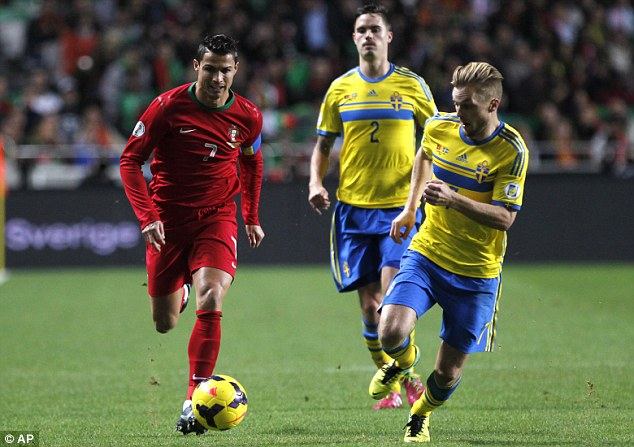 Muscle: Howard Webb won't mind Sweden roughing up Cristiano Ronaldo (left) says Sebastian Larsson