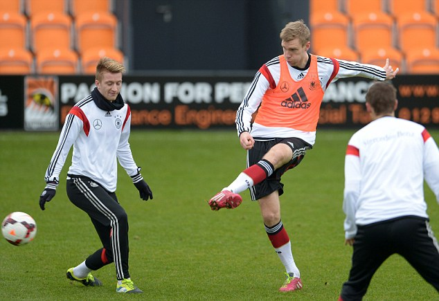 Tall order: Beanpole defender Per Mertesacker is likely to be handed a start against England