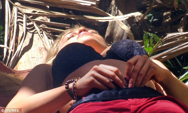 Keeping abreast of the jungle news: Amy strips down to her smalls for some relaxation
