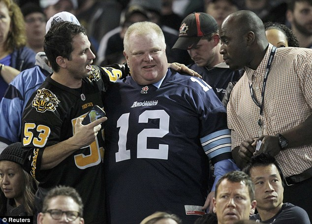 Meet and greet: Toronto Mayor Rob Ford gets close to a fan of the opposition