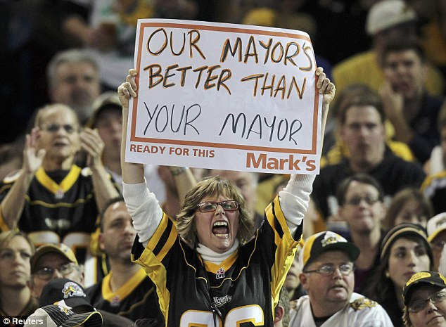 Taunted: A woman holds a sign mocking the rival team's city mayor