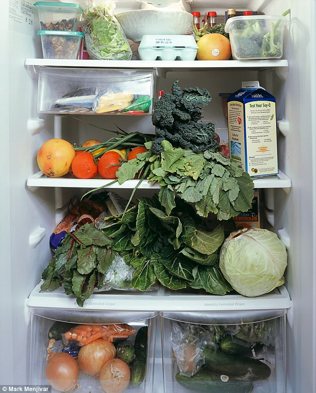 Health kick: The midwife and middle school science teacher who own this fridge were in their first week of eating all local produce when this picture was taken