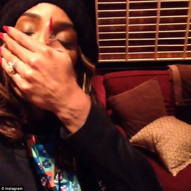 Put A Ring On It? Kelly Rowland is seen here in a new Instagram video sporting a diamond ring on her wedding finger amid speculation she has got engaged to her manager beau Tim Witherspoon