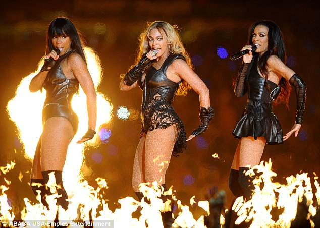 Reunited: Destiny's Child reformed for a performance at the Super Bowl earlier this year in New Orleans, Louisiana, seen with fellow bandmates Beyonce, centre, and Michelle Williams