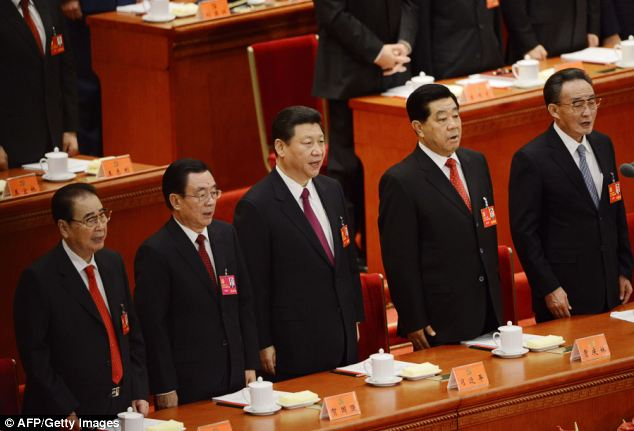 The Beijing News has reported that Mr Tao has been relieved of his duties in the country's Communist Party, which is led by Xi Jinping (centre)