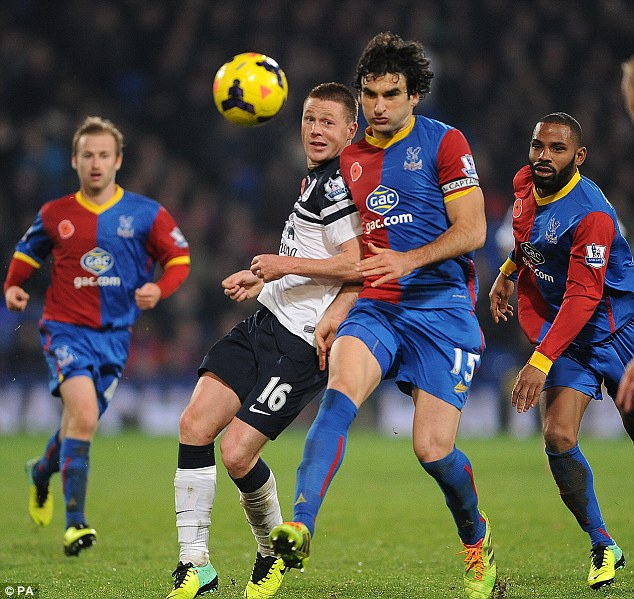 Battle: Everton's James McCarthy (centre left) challenges Mile Jedinak (centre right) for the ball