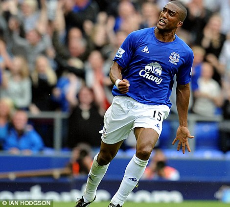 Old and new: Liverpool's Mark Wright and Everton's Sylvain Distin have scored in the derby