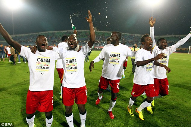 On the way to Brazil: Ghana stars celebrate reaching the 2014 World Cup despite defeat by Egypt