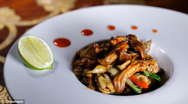 Tasty tongue: Diners can enjoy the £14 bull and duck tongue stir-fry mixed with Ho Fun noodles, choy sum and peashoots