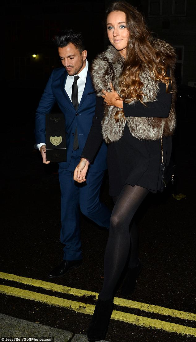 All wrapped up: Peter Andre's pregnant girlfriend Emily MacDonagh kept her bump hidden beneath a fur gilet
