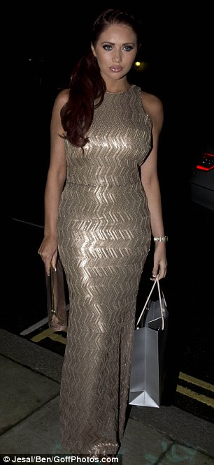 Golden girl: Amy Childs also attended the event and stood out in a gold dress