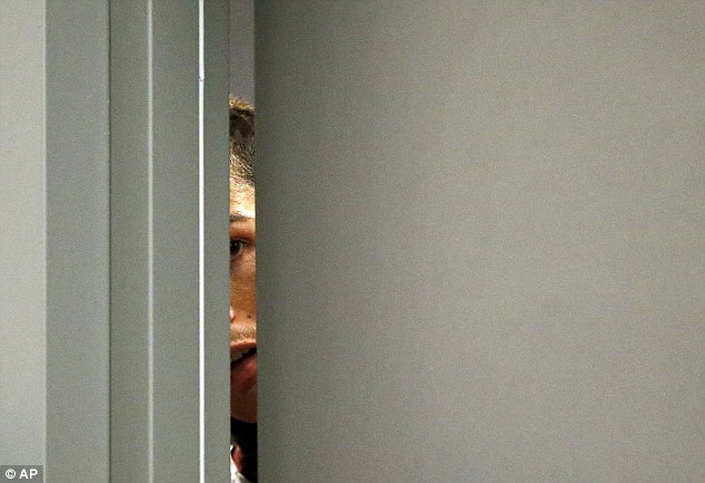 Rise and shine: Cristiano Ronaldo peeks out of his hotel door, although this was not related to RIX FM's alarm call