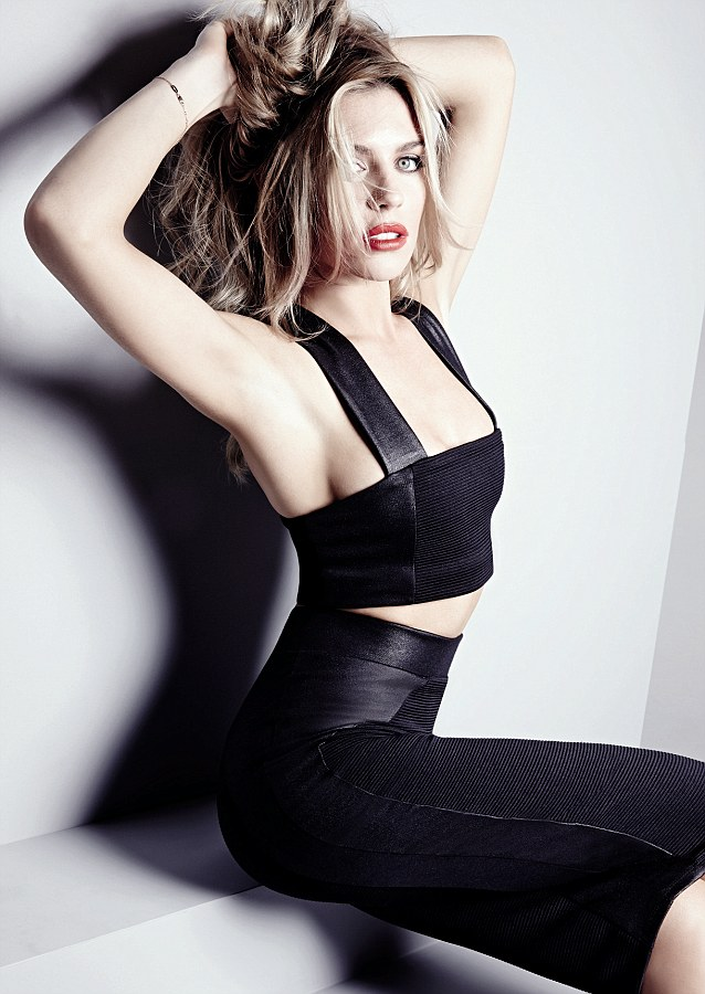 Abbey Crouch poses in her new collection for Matalan with bold red lips and wild hair. Here Abbey wears skirt suit, £25
