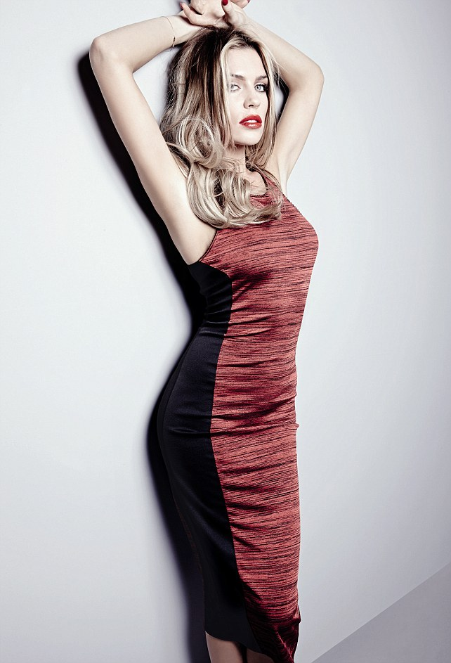 Abbey shows off the results of her tough rehearsal schedule for Strictly, Abbey wears red dress £20