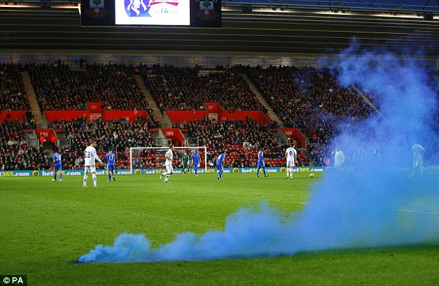 Not so saintly: A flare is thrown on to the pitch at an FA Cup at Southampton's St Mary's ground earlier this year