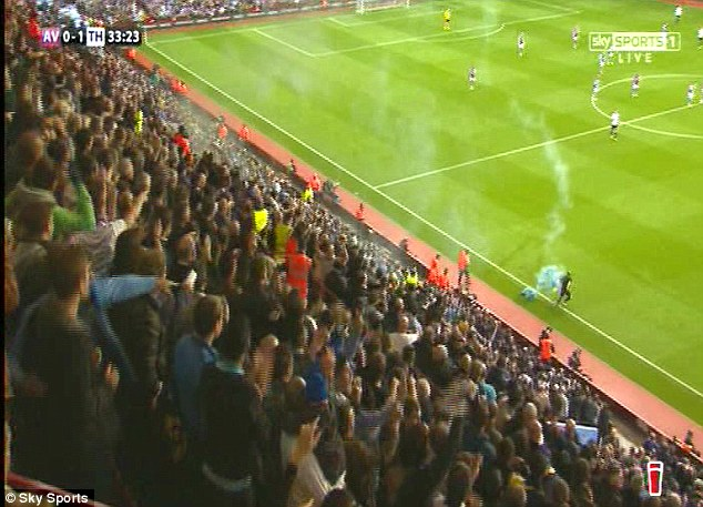 Natural reaction: A supporter threw the flare which landed near his children to protect them