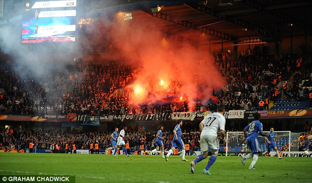 Red is the colour: Basle fans light up flares at Stamford Bridge in last season's Europa League