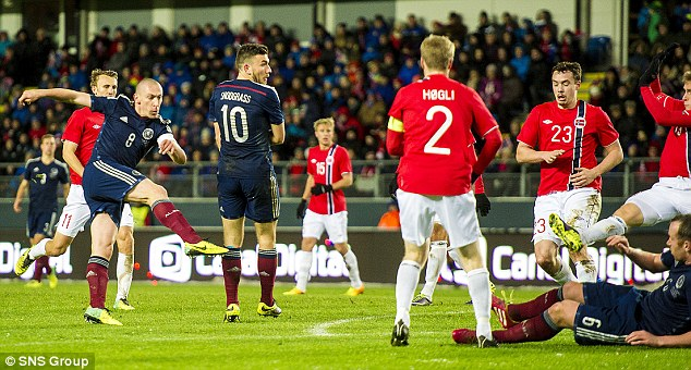 No mistake: Scott Brown (front left) fires through a crowd of bodies to open the scoring in Molde