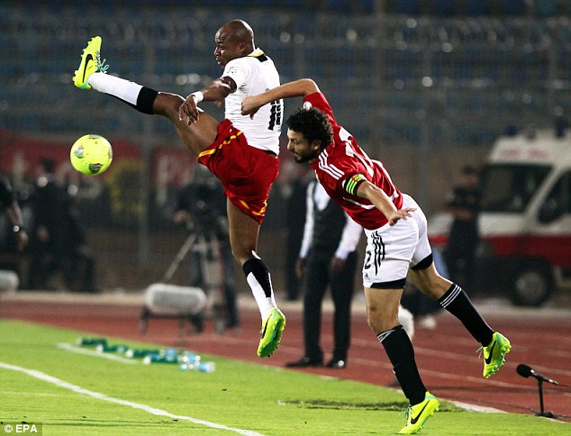 Stretch: Hossam Ghaly (right) tries to reach the ball ahead of Ghana's Andre Ayew (left)