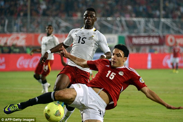 Tussle: Ghana's Edwin Gyimah (left) fights for the ball with Mohamed Mohamed Nagy