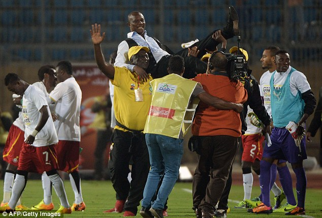 Here we are: Ghana's head coach James Kwesi Appiah is lifted up into the air after the country's qualification