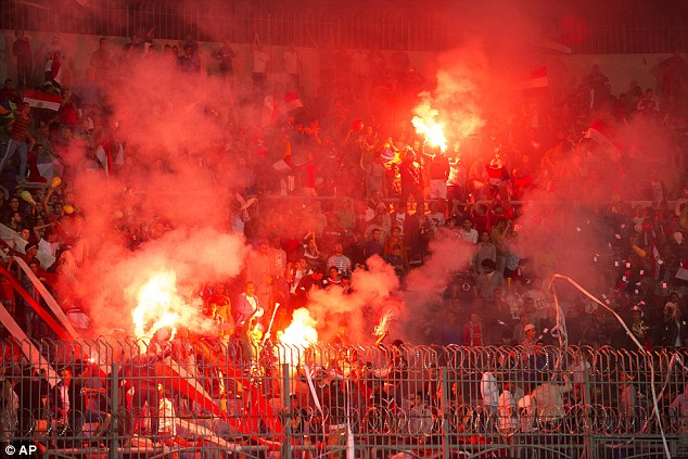 Red hot: Egypt supporters burn flares at the World Cup qualifying playoff game