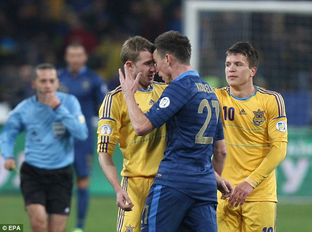 Head to head: Koscielny was sent off for scrapping with Oleksandr Kucher towards the end of the first leg