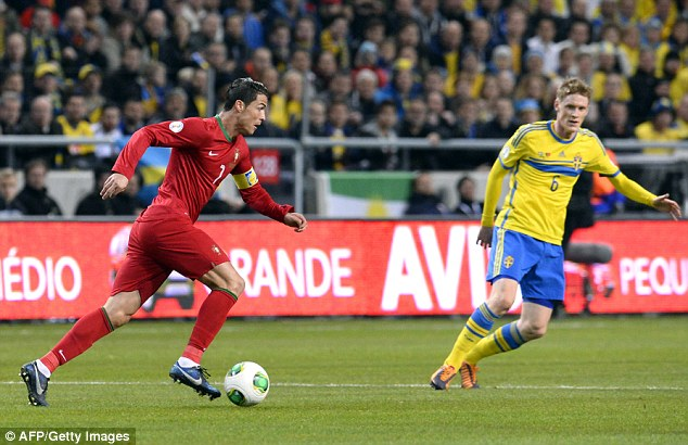 Man on a mission: Ronaldo (left) drove through the heart of the Swedish defence to net a hat-trick