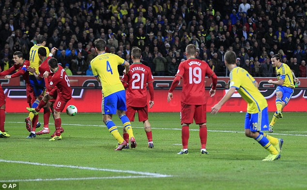 Making it count: Ibrahimovic kept a cool head to fire home Sweden's second goal from a free-kick