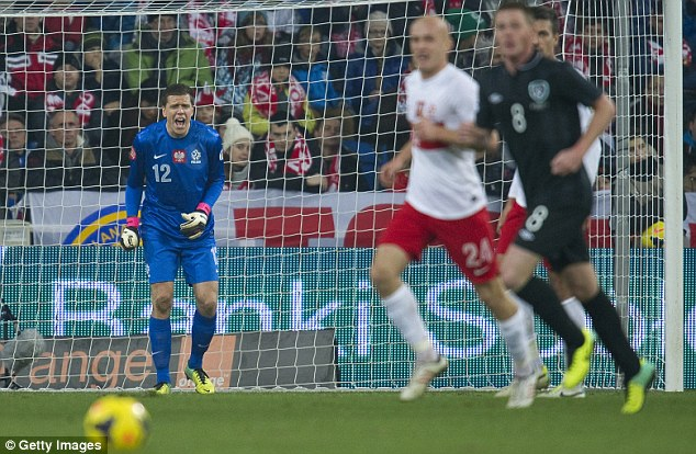 Commanding: Poland's in-form goalkeeper Wojciech Szczesny repeatedly ordered his defence around