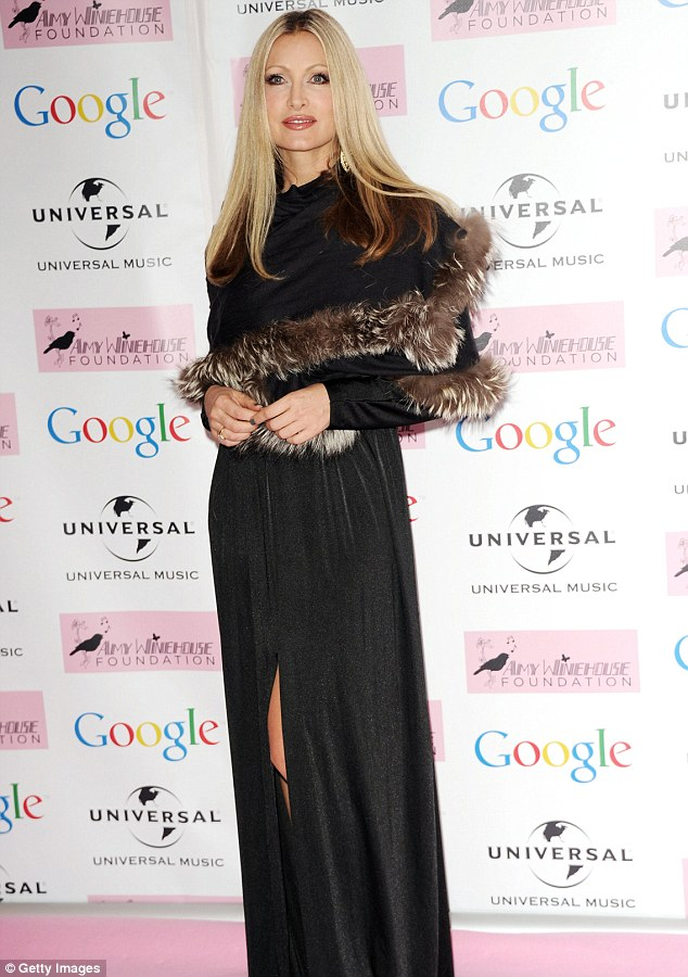 Furry elegant: Caprice looked ladylike in a long sleeved black dress with a fur trim