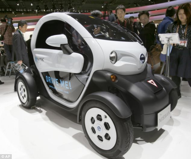 A Nissan New Mobility concept car is displayed at the media preview for the Tokyo Motor Show. Small has proven big with a number of carmakers showcasing tiny electric vehicles in which the passenger sit in tandem