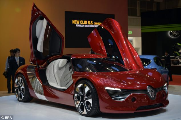 The DeZir is an all-electric two seater coupé with butterfly doors, a top speed of 112 mph and the interior is of red leather