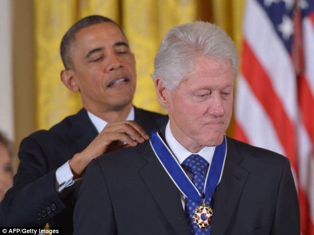 Awkward: On Wednesday Obama presented the Presidential Medal of Freedom to former President Bill Clinton, the politician who did more than anyone else to send Democrats running for Obamacare's exit ramp