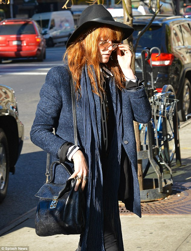 Let's get this straight: Florence quickly adjusted her precariously balanced glasses after stepping out to run some errands