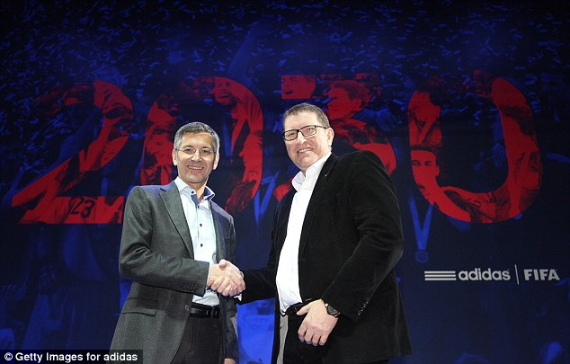 Shake on it: Adidas Group CEO Herbert Hainer (left) and FIFA Marketing Director Thierry Weil