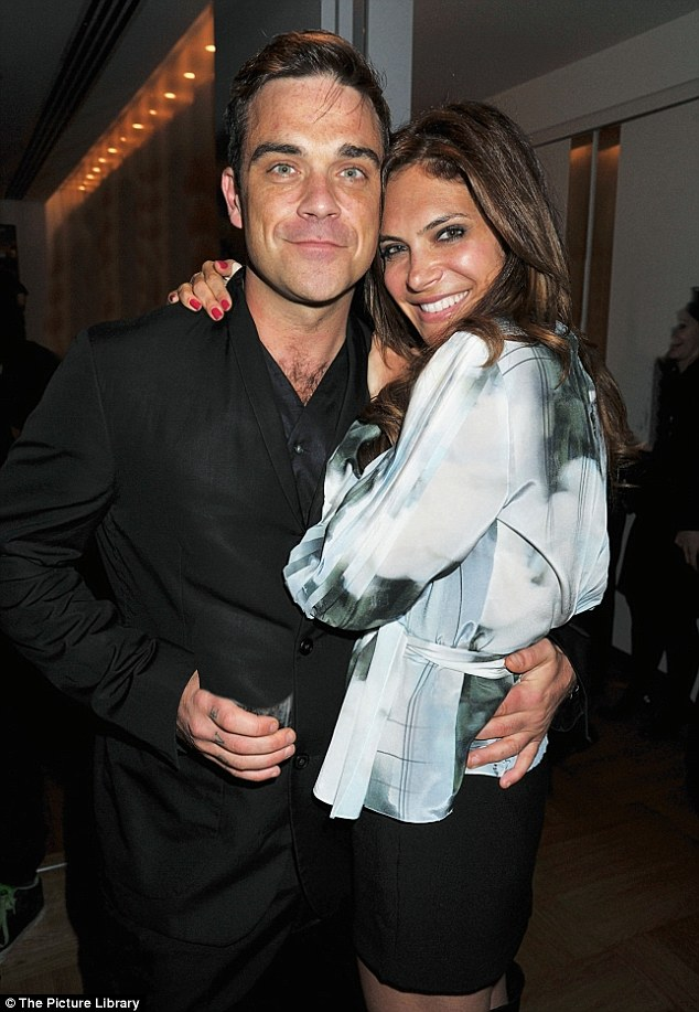 Happy ending: Robbie, 39, married Los Angeles-born Ayda Field, 34, in 2010, after dating for four years and proposing in 2009