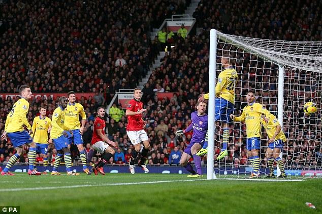 Winner: Former Gunner Robin van Persie (centre left) scores the sole goal in Manchester United's recent 1-0 win against Arsenal