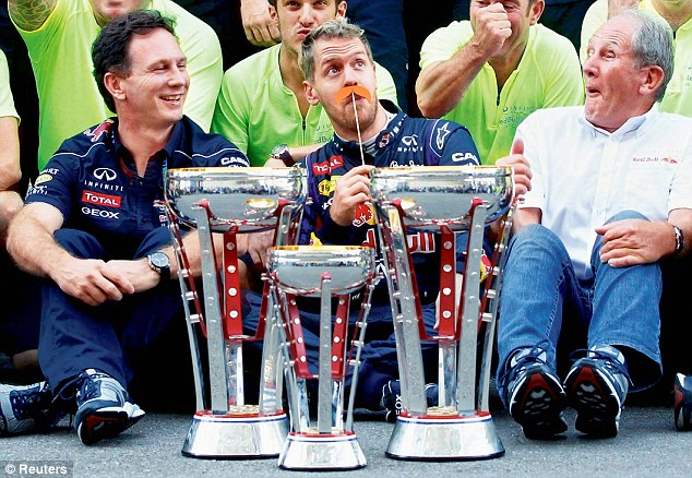 Champion: Sebastian Vettel (centre) jokes as he celebrates another win with Team Principal Horner (left)