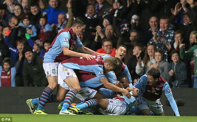 Relief: Aston Villa's Leandro Bacuna (centre) celebrates scoring in the 2-0 win over Cardiff