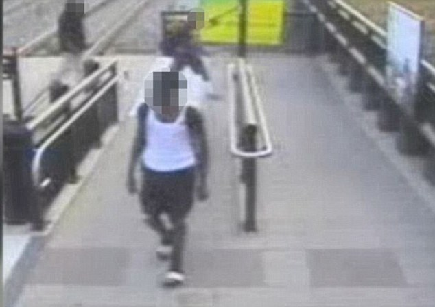 Caught on camera: Prosecutors believe three teens were involved in Santiago's death and were spotted on CCTV getting on the train