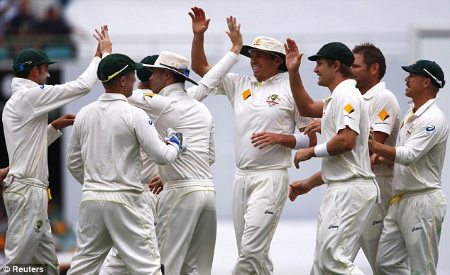 High fives: Australia, celebrating the wicket of Chris Tremlett, have taken full control of the first Test