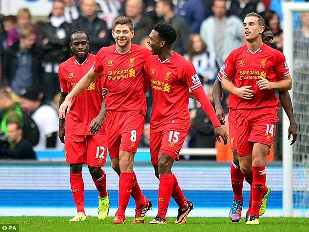 Captain marvel: Gerrard (second left) celebrates scoring against Newcastle earlier in the season